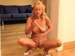Mature Blonde Gets Undressed To Masturbate