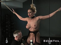 Busty sub tied up and vibed