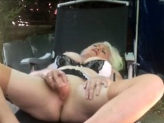 Charming granny fucks pussy outdoor with big sextoy