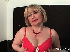Blonde mature temptress in lingerie flashing ass and boobs